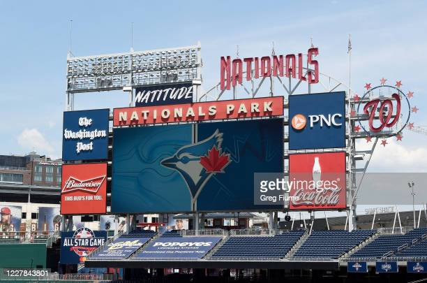 The Toronto Blue Jays logo is displayed on the video board during batting practice before the game against the Washington Nationals at Nationals Park...