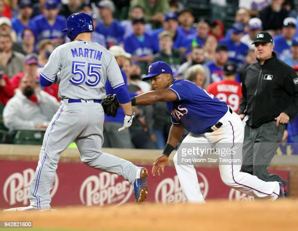 The Toronto Blue Jays' Russell Martin is tagged out by Texas Rangers third baseman Adrian Beltre in the fourth inning on Friday April 6 at Globe Life...
