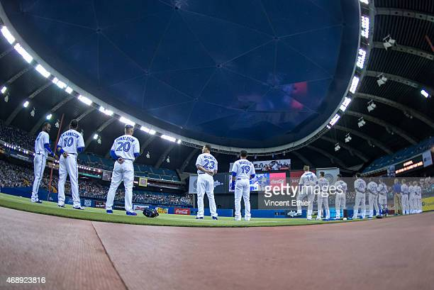 The Toronto Blue Jays stand for the Canadian National Anthem prior to the exhibition game against the Cincinnati Reds at Olympic Stadium on Friday...