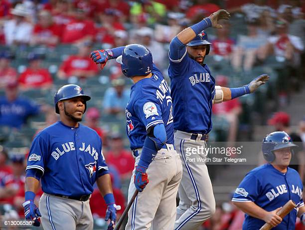 The Toronto Blue Jays' Troy Tulowitzki and Jose Bautista celebrate Bautista's threerun home run in the ninth inning against the Texas Rangers in Game...