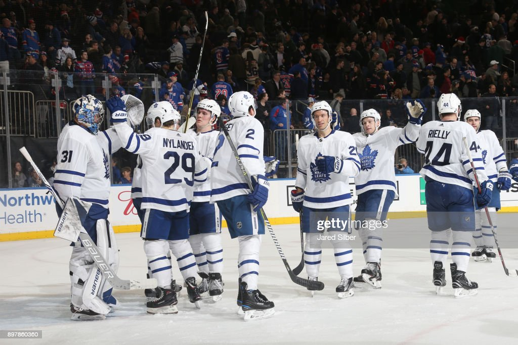 The Toronto Maple Leafs celebrate after defeating the New York Rangers 3-2 at Madison Square Garden on December 23, 2017 in New York City.