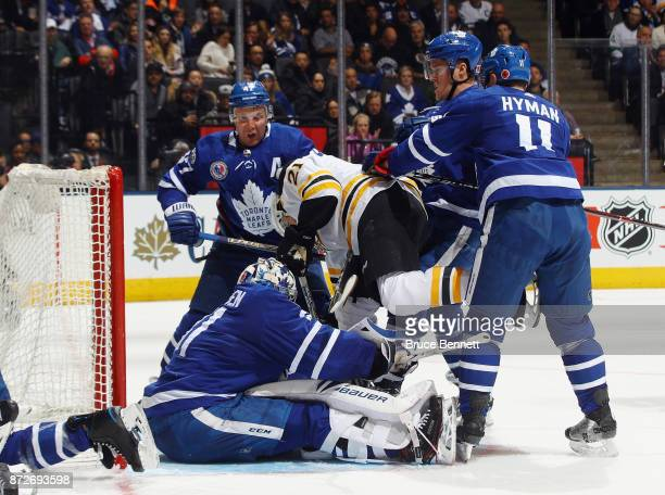 The Toronto Maple Leafs defend against Jordan Szwarz of the Boston Bruins during the third period at the Air Canada Centre on November 10 2017 in...