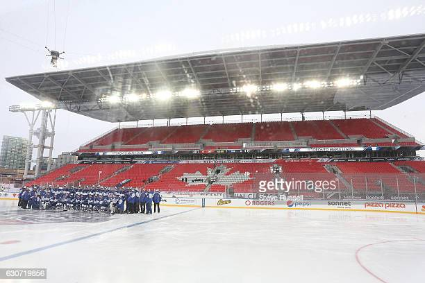 The Toronto Maple Leafs pose for a photo before practice on the eve of the Centennial Practice at Exhibition Stadium in Toronto. December 31, 2016.