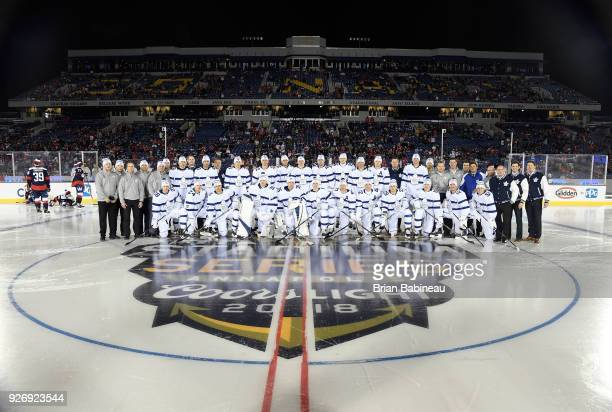 The Toronto Maple Leafs pose for a team photo at center ice prior to the 2018 Coors Light NHL Stadium Series game between the Toronto Maple Leafs and...