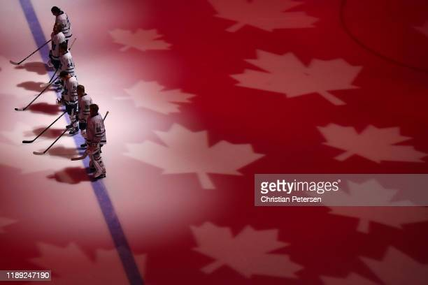 The Toronto Maple Leafs stand attended for the Canadian national anthem before NHL game against the Arizona Coyotes at Gila River Arena on November...