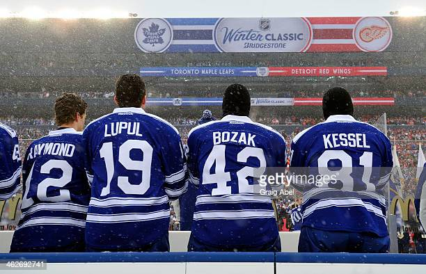 The Toronto Maple Leafs stand for the playing of the national anthems before action against the Detroit Red Wings during NHL game action during the...