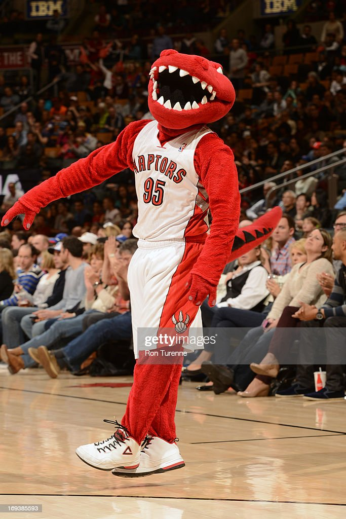 The Toronto Raptor cheers on the crowd against the Brooklyn Nets during the game on April 14, 2013 at the Air Canada Centre in Toronto, Ontario, Canada.