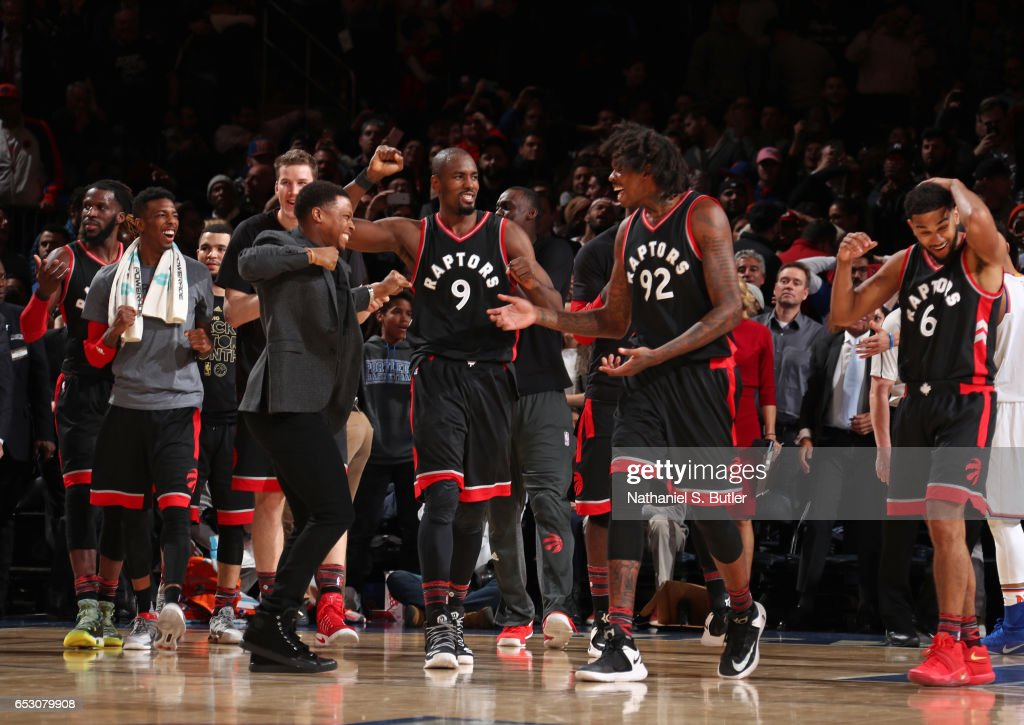 The Toronto Raptors celebrate during the game against the New York Knicks on February 27, 2017 at Madison Square Garden in New York City.