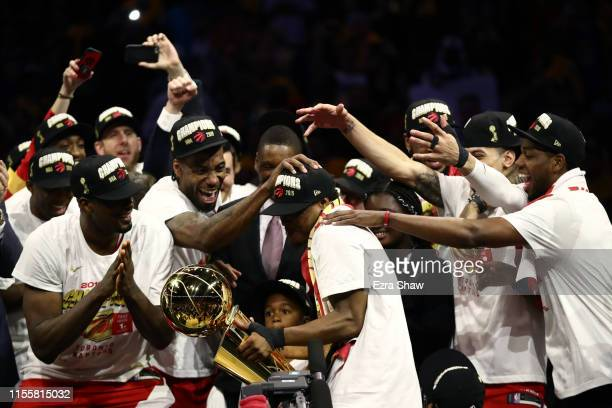 The Toronto Raptors celebrate with the Larry O'Brien Championship Trophy after defeating the Golden State Warriors to win Game Six of the 2019 NBA...