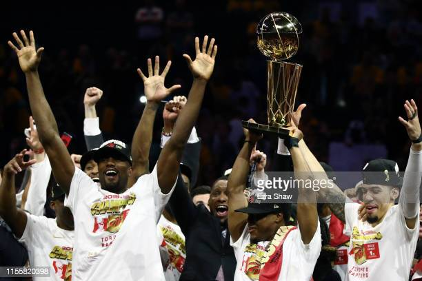 The Toronto Raptors celebrate with the Larry O'Brien Championship Trophy after their team defeated the Golden State Warriors to win Game Six of the...
