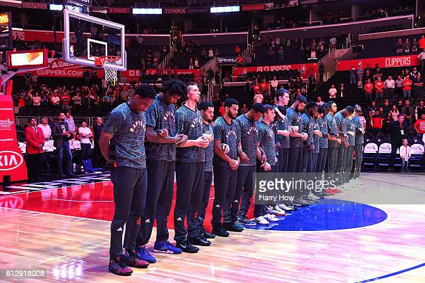 The Toronto Raptors line up for the National Anthem before a preseason game against the Los Angeles Clippers at Staples Center on October 5 2016 in...