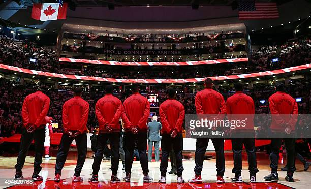 The Toronto Raptors line up for the national anthems prior to the NBA season opener against the Indiana Pacers at Air Canada Centre on October 28...