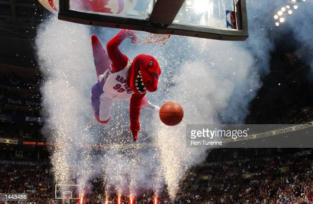 The Toronto Raptors mascot flies through fireworks for the jam during a break in a game against the Detroit Pistons during game 4 of the Eastern...