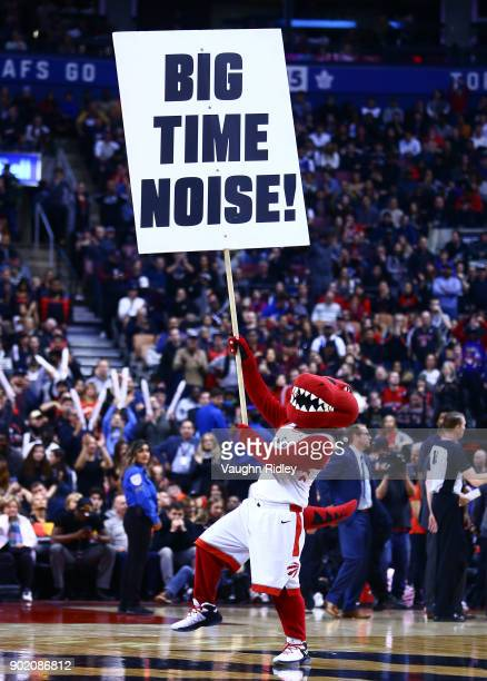 The Toronto Raptors mascot The Raptor waves a sign during the second half of an NBA game against the Milwaukee Bucks at Air Canada Centre on January...