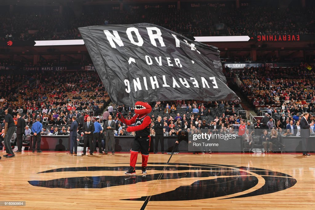 The Toronto Raptors mascot waves the team flag before the game against the New York Knicks on February 8, 2018 at the Air Canada Centre in Toronto, Ontario, Canada.