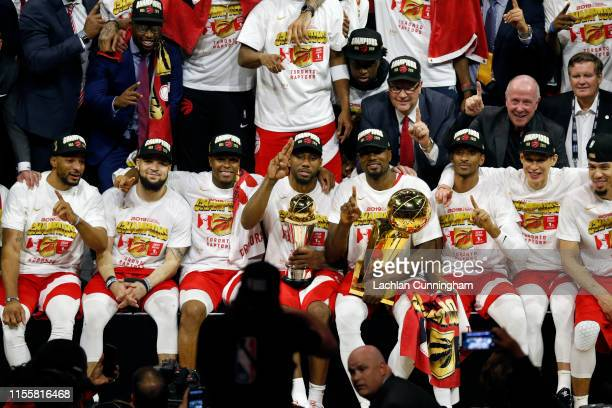 The Toronto Raptors pose for a photo after their team defeated the Golden State Warriors to win Game Six of the 2019 NBA Finals at ORACLE Arena on...