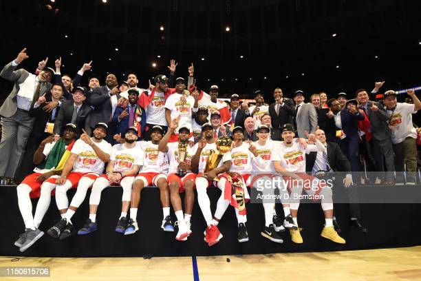 The Toronto Raptors pose for a photo on stage with the Larry O'Brien Championship Trophy after defeating the Golden State Warriors in Game Six of the...