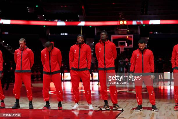 The Toronto Raptors stand for the national anthem before the game against the Miami Heat January 20, 2021 at Amalie Arena in Tampa, Florida. NOTE TO...