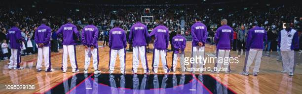 The Toronto Raptors stand for the National Anthem prior to a game against the Boston Celtics on November 2 1999 at the Air Canada Centre in Toronto...