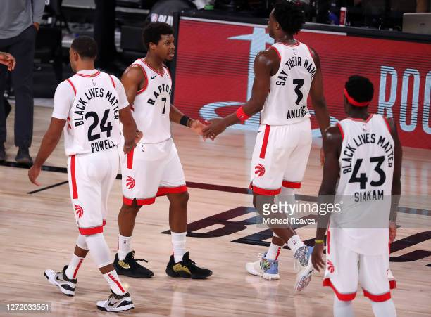 The Toronto Raptors teammates Kyle Lowry of the Toronto Raptors and OG Anunoby of the Toronto Raptors react during the fourth quarter against the...