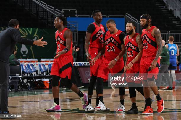 The Toronto Raptors walk off the court during the game against the Milwaukee Bucks on February 18, 2021 at the Fiserv Forum Center in Milwaukee,...