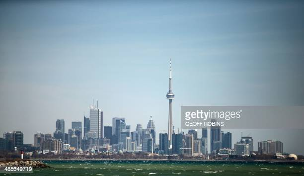 The Toronto skyline is seen from a lakefront park west of downtown on April 17 2014 AFP PHOTO/GEOFF ROBINS