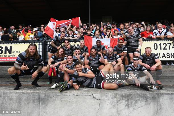 The Toronto Wolfpack team pose for a photograph with their fans after the Betfred Championship match between Bradford Bulls and Toronto Wolfpack at...