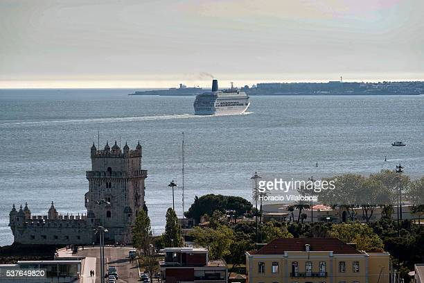 The Torre de Belem stands on the foreground as the PO Cruises fleet MV Oriana sails on the mouth of Tagus River after leaving harbor on June 1 2016...