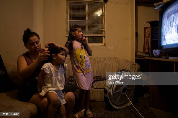 "The Toscano family preparing for bedtime in Rio Bravo, Texas. In Texas, ""colonia"" refers to an unincorporated settlement, found largely along the..."