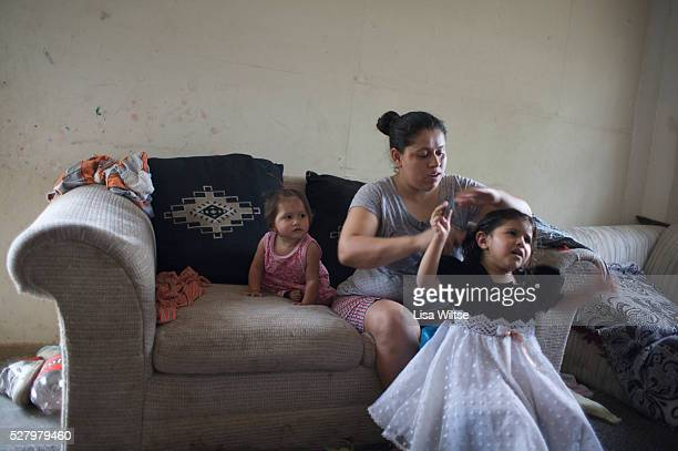 """The Toscano family preparing for church in Rio Bravo, Texas. In Texas, """"colonia"""" refers to an unincorporated settlement, found largely along the..."""