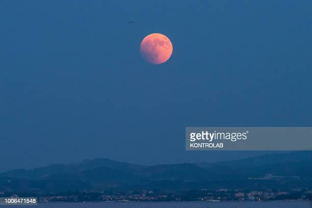 The total eclipse of the moon which turns red on the Ionian sea The lunar eclipse is considered the longest eclipse of the century as it lasts 103...