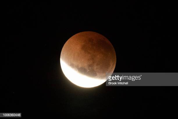 The total lunar eclipse viewed over Sydney Australia from Observatory Hill Park on July 28 2018 in Sydney Australia The period of totality during...