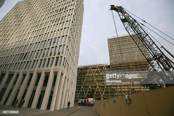 The Total tower, the German headquarter of Total SA, left, and the 50Hertz Transmission GmbH headquarter, right, stand on the construction site of...