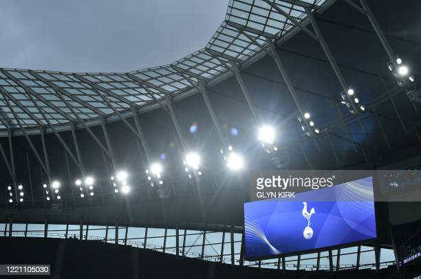The Tottenham cockerel is displayed on a screen ahead of the English Premier League football match between Tottenham Hotspur and Manchester United at...