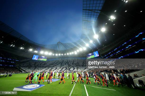 The Tottenham Hotspur and Manchester City players walk out prior to the UEFA Champions League Quarter Final first leg match between Tottenham Hotspur...
