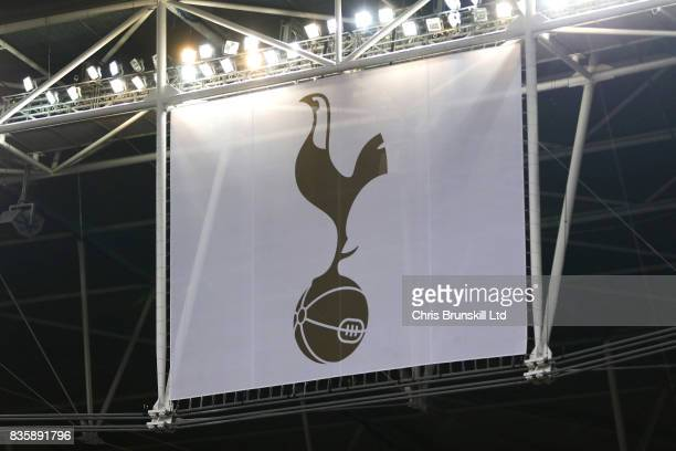 The Tottenham Hotspur club crest is seen on banner above Wembley Stadium during the Premier League match between Tottenham Hotspur and Chelsea at...
