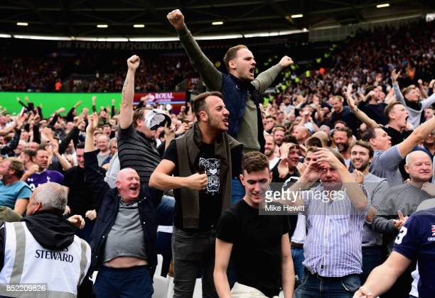 The Tottenham Hotspur fans celebrate during the Premier League match between West Ham United and Tottenham Hotspur at London Stadium on September 23...