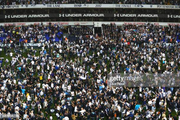 The Tottenham Hotspur fans invade the pitch after the Premier League match between Tottenham Hotspur and Manchester United at White Hart Lane on May...
