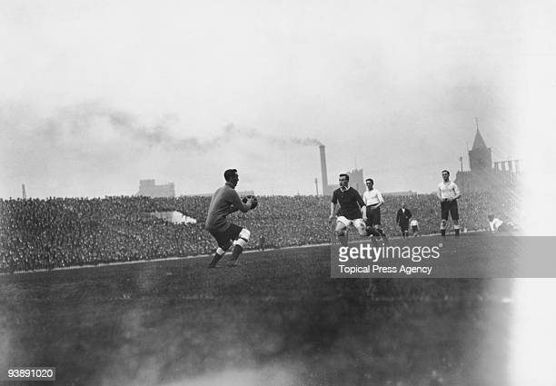The Tottenham Hotspur goalkeeper about to make a clearance during a league match against Manchester United at Old Trafford, 4th October 1913....
