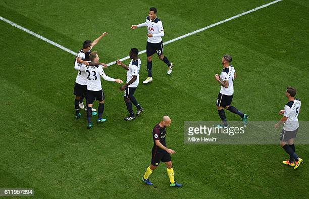 The Tottenham Hotspur players celebrate their sides first goal after Aleksander Kolorov of Manchester City scores a own goal during the Premier...