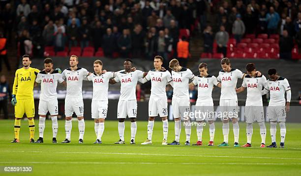 The Tottenham Hotspur players observe a minutes silence for the victims of the plane crash involving the Brazilian club Chapecoense prior to kick off...