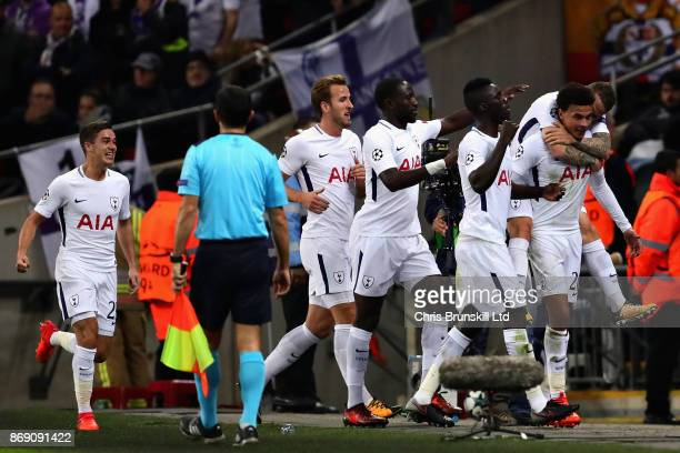 The Tottenham Hotspur team celebrate the goal of Dele Alli during the UEFA Champions League group H match between Tottenham Hotspur and Real Madrid...