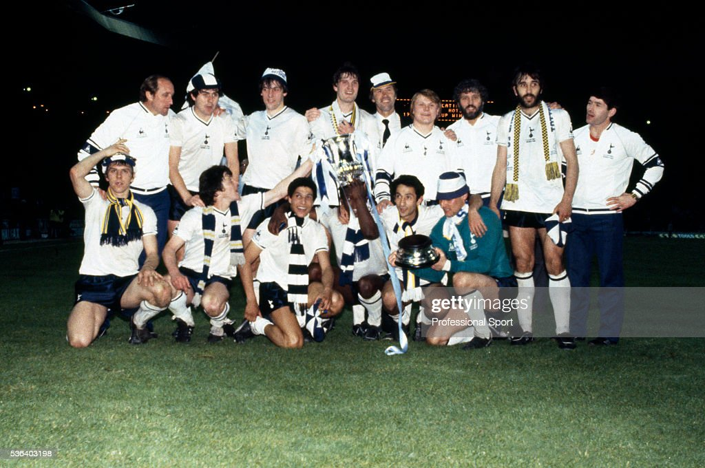 The Tottenham Hotspur team celebrate with the trophy after the FA Cup Final Replay between Tottenham Hotspur and Manchester City at Wembley Stadium in London, 14th May 1981. Tottenham Hotspur won 3-2. Back row (left-right) Peter Shreeves (assistant manager), Paul Miller, Tony Galvin, Glenn Hoddle, Keith Burkinshaw, Garry Brooke, Mike Varney (physio), Ricardo Villa, unidentified. Front row: Graham Roberts, Steve Perryman, Chris Hughton, Garth Crooks, Osvaldo Ardiles and Milija Aleksic.