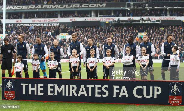 The Tottenham Hotspur team line up prior to kick off during The Emirates FA Cup QuarterFinal match between Tottenham Hotspur and Millwall at White...
