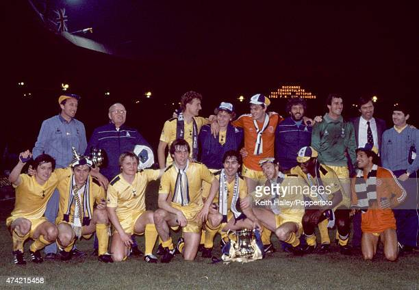 The Tottenham Hotspur team pose with the trophy after their victory over Queens Park Rangers in the FA Cup Final Replay at Wembley Stadium in London...