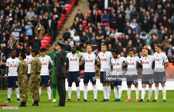 The Tottenham Hotspur team take part in a minute of silence for remebrance day prior to the Premier League match between Tottenham Hotspur and...