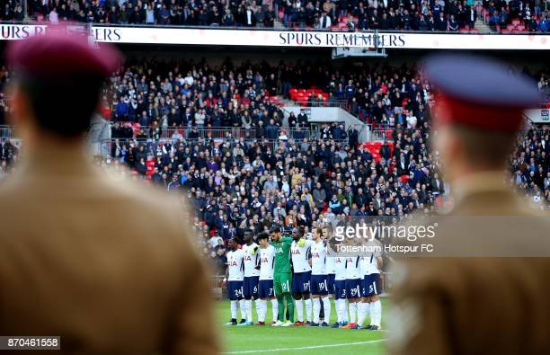 The Tottenham Hotspur team take part in a minute of silence for remeberance day prior to the Premier League match between Tottenham Hotspur and...