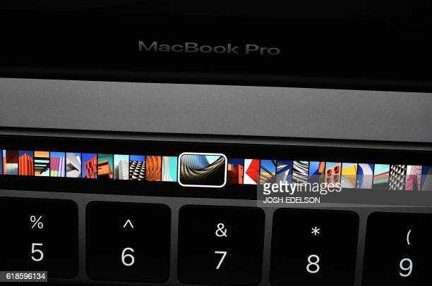 The Touch Bar is seen on a display on a wall during a product launch event at Apple headquarters in Cupertino California on October 27 2016 Apple...