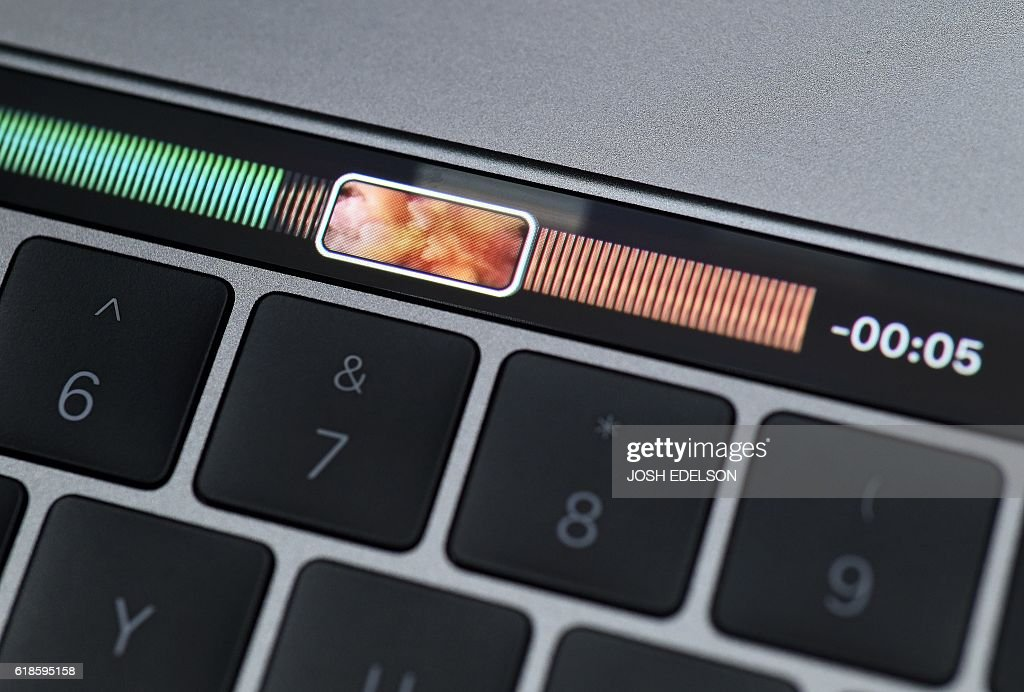 The Touch Bar is seen on a new MacBook Pro during a product launch event at Apple headquarters in Cupertino, California on October 27, 2016. Today, Apple revealed its new line of MacBook Pro laptops as well as a new Apple TV app.