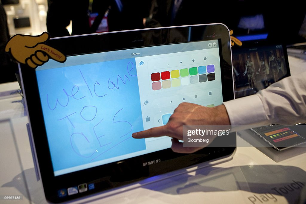 The touch functionality of Samsung Electronics Co.'s DM-U200 touchscreen all-in-one computer is demonstrated by Dustin Serbin during the 2010 International Consumer Electronics Show (CES) in Las Vegas, Nevada, U.S., on Friday, Jan. 8, 2010. 20,000 new technologies will debut at CES, which runs through Jan. 11 and is expected to see at least 113,000 attendees and 2,500 exhibitors, the Consumer Electronics Association said. Photographer: Daniel Acker/Bloomberg via Getty Images